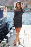 Luxury woman is resting near boat Stock Photo