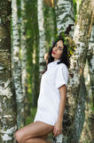 Luxury woman in shirt standing near the birches Royalty Free Stock Photo