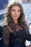 Luxury woman is sitting near boat Royalty Free Stock Photos