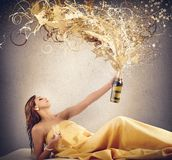 Luxury women. Rich luxury woman blows up the champagne Royalty Free Stock Photos