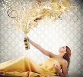 Luxury women. Rich luxury woman blows up the champagne Stock Photos