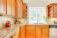 Luxury Wood kitchen with granite and window. Stock Images