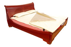 Luxury wooden bed isolated Stock Image