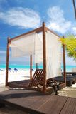 Luxury wooden chaise lounge. On beautiful caribbean beach in Dominican Republic Royalty Free Stock Images
