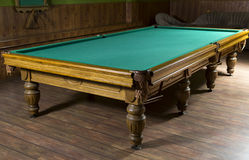 Luxury wooden pool tables in the room Royalty Free Stock Photo