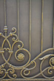 Luxury Wrought Iron Fence Detail. Rust and chipping paint add grungy detail to this old wrought iron gate Royalty Free Stock Photography