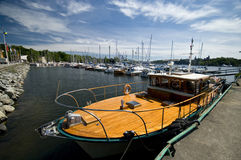 Luxury yacht. A luxury wooden yacht moored in Stockholm marina Royalty Free Stock Images