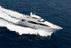 Luxury yacht. Top view of luxury yacht cruising in the ocean Stock Photography