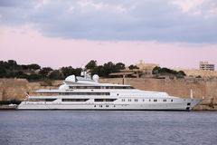 Luxury yacht. Luxury white yacht berthed in malta stock images