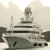 Luxury yacht. Three decker luxury yacht arriving at a marina, prepared with its fenders out royalty free stock images