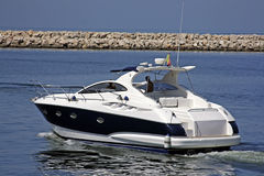 Luxury Yacht. Going in the sea from Harbour royalty free stock images