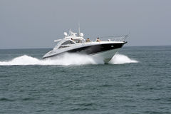 Luxury Yacht. Going in the sea from Harbour stock photos