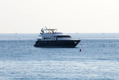 Luxury yacht anchored in the bay Royalty Free Stock Photo