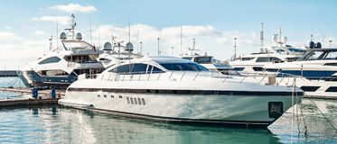 Luxury yacht anchored in bay. Side view of luxury yacht anchored in bay at summer day. Private motor boats royalty free stock images