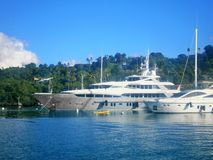 Luxury yacht anchored in front op a tropical island Stock Photo