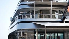 Luxury yacht anchored at harbor. Luxury dark blue yacht anchored at harbor. Also establishing shot stock video footage