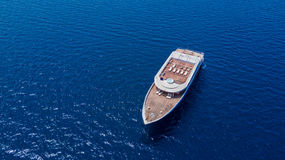 Luxury yacht anchoring on open ocean, sailing and travel theme Royalty Free Stock Image