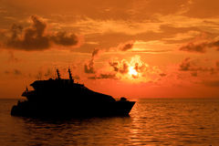 Luxury Yacht boat at sunset Stock Photo