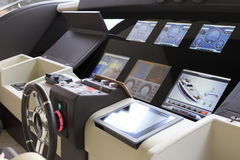 Luxury yacht cab. Instrument panel and steering wheel of a luxury yacht cockpit Royalty Free Stock Photography