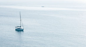 Luxury yacht in the calm ocean Royalty Free Stock Image