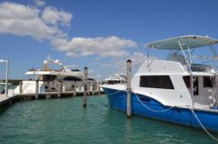 Luxury Yacht and Charter Deep Sea Fishing Boat. Luxury yacht and charter dee sea fish boat moored at a marina on Haulover inlet in southeast Florida Stock Photography