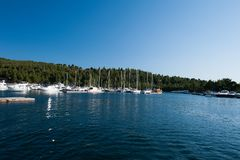 A luxury yacht at the yacht club in the port royalty free stock photo
