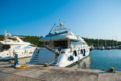 A luxury yacht at the yacht club in the port stock photos