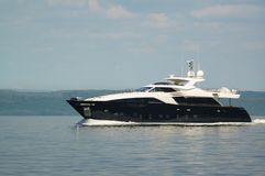 Luxury Yacht. Cruising in the sea. Amur bay, Russia royalty free stock photos