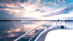 Luxury yacht deck. Shipping into sunset stock photography