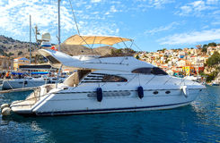 Luxury yacht docked in the marina of Simi island. royalty free stock images