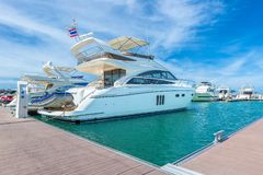 Luxury yacht docked in the parking of boats. A luxury yacht docked in the parking of boats and yachts in Ocean Marina Thailand stock photo