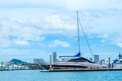 Luxury yacht docked in the parking of boats. A luxury yacht docked in the parking of boats and yachts in Ocean Marina at Pattaya, Thailand royalty free stock photo