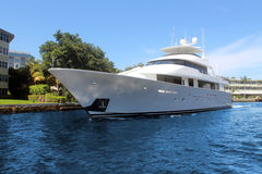 Luxury yacht in front of house. Luxury and modern yacht in front of house royalty free stock photography