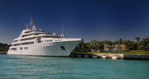 Luxury Yacht in front of tropical island Stock Photos