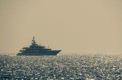 Luxury yacht on glittering sea Stock Photography