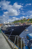 Luxury yacht in the harbor of halden, blue charm Stock Images