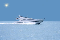 Luxury yacht with horizon line stock photography