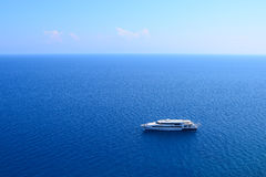 Luxury Yacht. Lonely boat in the sea Royalty Free Stock Photography