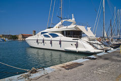 Luxury yacht in mandraki harbour Royalty Free Stock Photo