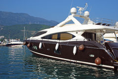 Luxury yacht in marina Stock Images