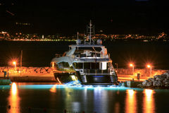 Luxury yacht moored on pier night Stock Image