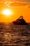 Luxury yacht on open sea at golden sunset Royalty Free Stock Images