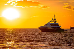 Luxury yacht on open sea at golden sunset Royalty Free Stock Image