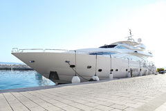 Luxury yacht parked at dock Stock Image
