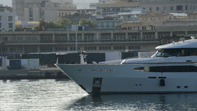 Luxury yacht passing in port at sunset stock video