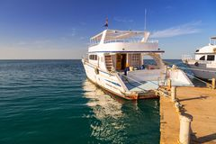 Luxury yacht at the pier of Red Sea royalty free stock image