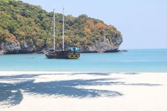 Luxury yacht sailing in the tropical island , white sand beach and sea at Samui. Gulf of Thailand royalty free stock photos