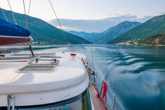 A luxury yacht sails through the bay Stock Image