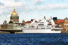 Luxury yacht in Saint Petersburg. (Russia) with St. Isaac cathedral on the background royalty free stock images