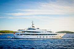 Luxury yacht anchored in bay in the Adriatic sea. Luxury yacht anchored in a beautiful bay in the Adriatic Sea under the blue sky Stock Photos